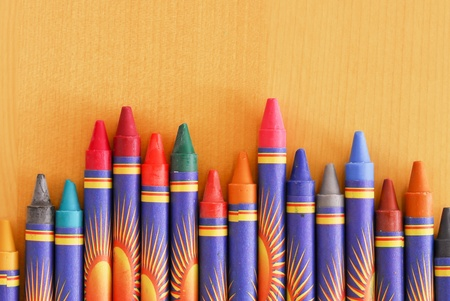 Staggered Crayons on Wood Table photo