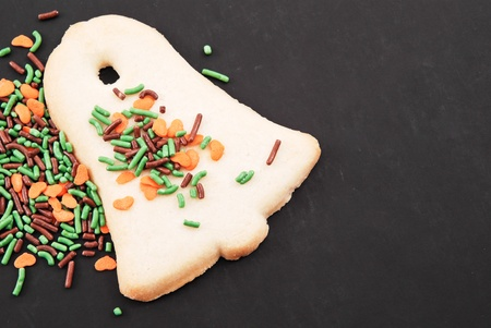 Bell Shaped Sugar Cookie and Sprinkles Stock Photo - 11960887