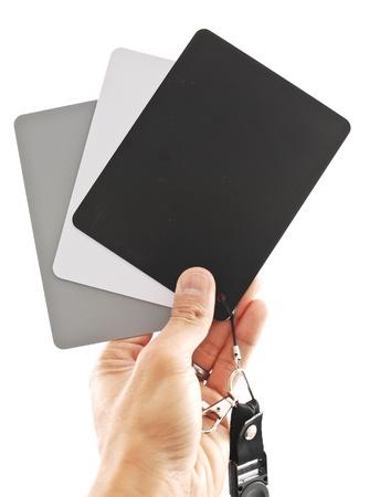 Hand Holding White Balance Measurement Cards photo