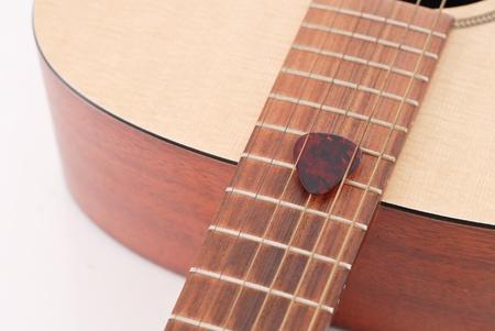 art lessons: Heavy Guitar Pick in Between Guitar Strings Stock Photo
