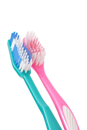 bad hygiene: Close Up of 2 Toothbrushes Against white Background Stock Photo