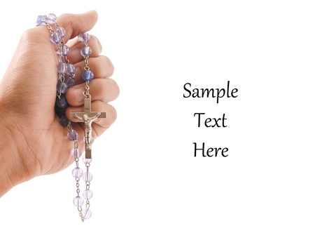 Hand with Religious Rosary with Space For Text photo