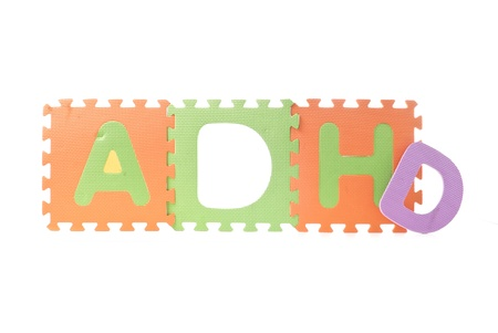 hyperactivity: ADHD Spelled out with Foam Toy Puzzle Squares Stock Photo