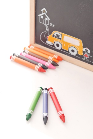 Red Green and Blue Crayons with Chalk Board photo