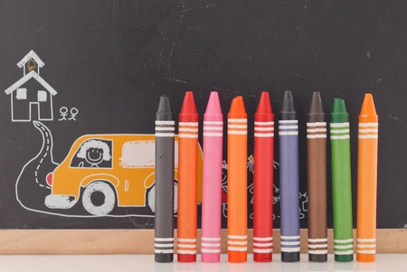 Crayons with Chalk board Background photo
