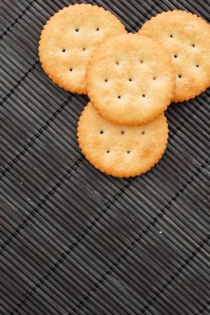 munch: Crackers on bamboo Stock Photo