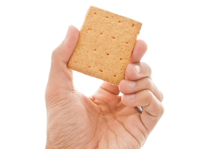 Hand with Graham Cracker on White Background photo