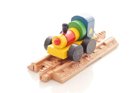 juguetes antiguos: Tren de juguete de madera en la pista de plástico