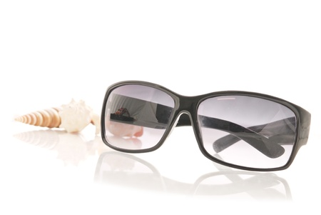 getaways: Womens Sunglasses with Shells in Background