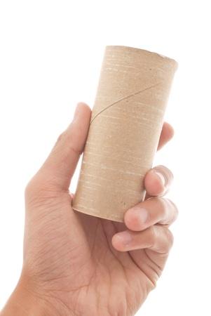 papel higienico: Mano que sostiene un rollo vacío de papel higiénico