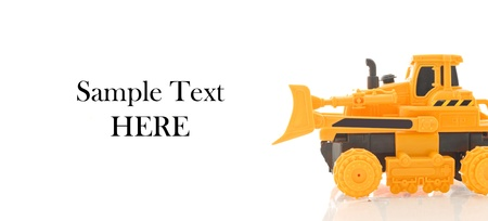 Bulldozer Truck Toy Against white Background and space for Text photo
