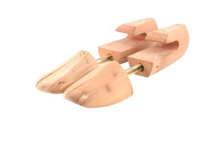 two cedar shoe trees on a white background