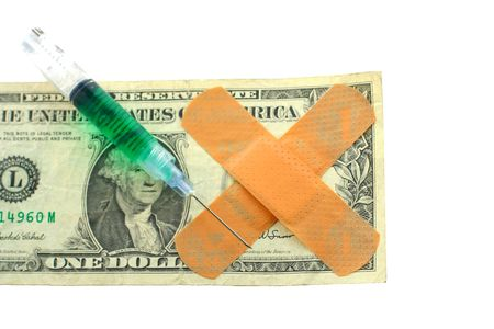 US dollar bill with bandaids and filled syringe with needle