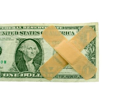 US dollar bill with bandaids