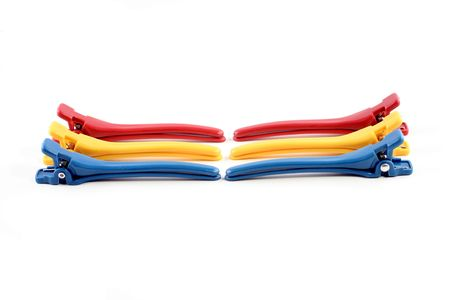 six colored duck billed hair clips on a white background