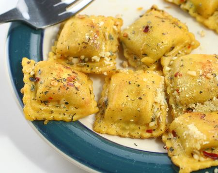 Cooked ravioli with spices on a plate Stock Photo