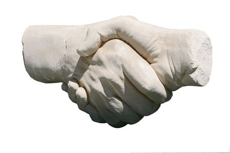 grasping: stone handshake sculpture isolated on white background
