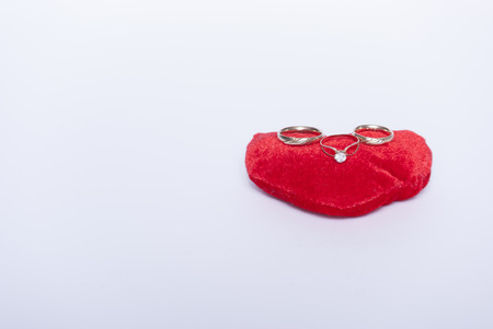 heart with wedding and engagement rings