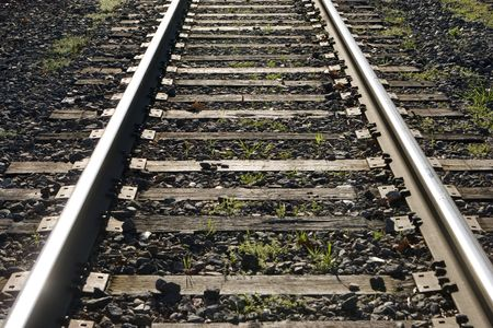 angled view: A close-up, angled view of train tracks. Stock Photo