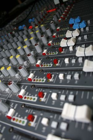 tilted: A mixing board viewed from a tilted angle.