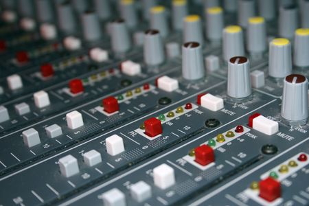 music venue: An angled view of a large mixing board from a live music venue.