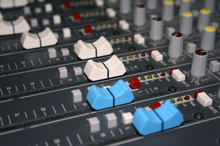 leds: A close-up view of the faders on a large mixing board. Stock Photo