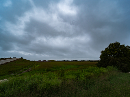 Beautiful blue overcast, cloudy sky over lush green Texas hill country