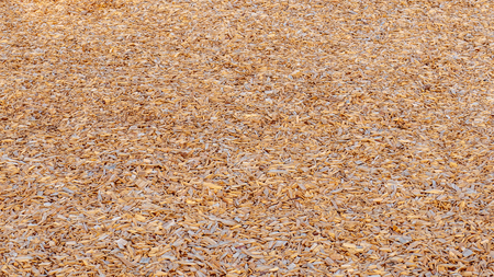 Background of wood chips covering the ground at a playground