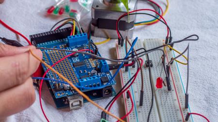 Microcontroller build closeup showing components, board and shield 版權商用圖片