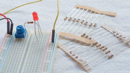 Potentiometer, resistors and red LED set up on a breadboard