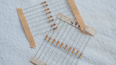 Packs of electrical resistor components against a white background
