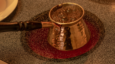 Copper briki for Greek and Turkish coffee, with coffee cooking