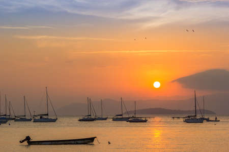 ocean sunset: Sunset on the bay with many boats. Stock Photo