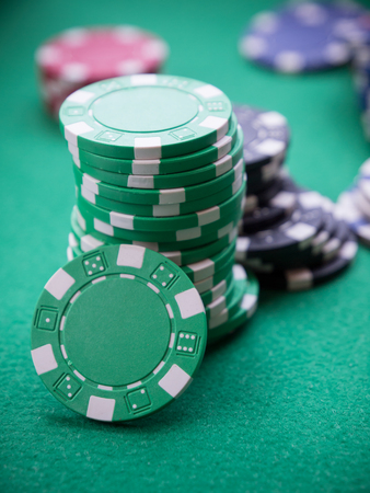 stacks of poker chips on green table