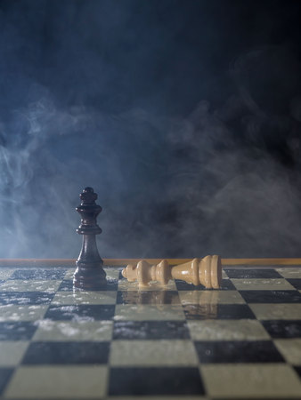 Chess figures on a dark background with smoke and fog. Lose and win concept. Selective focus Stok Fotoğraf