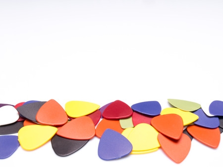 Guitar picks isolated on white background with space for text Banco de Imagens