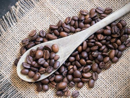 coffee beans background with wooden spoon Banco de Imagens