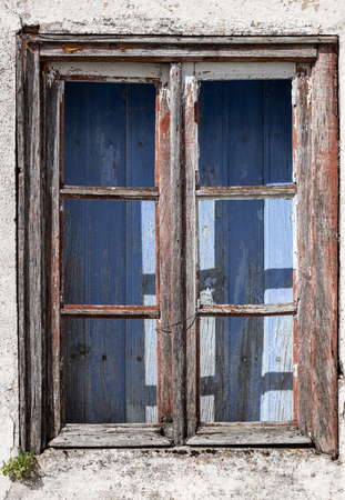 old window of abandoned house in ruins