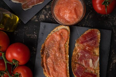 Toast with ham, oil and tomato. Mediterranean breakfast, Spanish cuisine