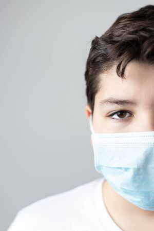 portrait of boy with coronavirus protective mask looking at camera with copyspace Reklamní fotografie