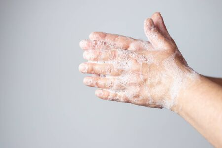 hand washing with soap to protect against the spread of the coronavirus