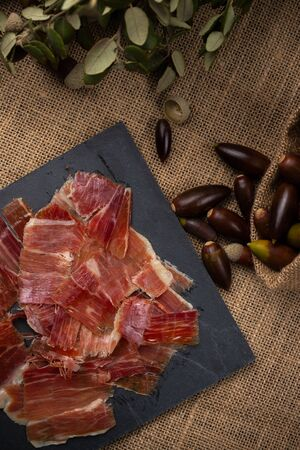 Acorn ham concept. pork product fed with oak acorns, also known in Spain as black legged ham