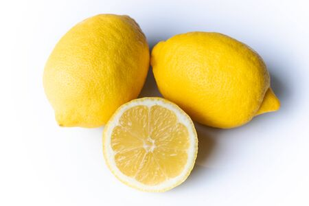 Two and a half lemons isolated on a white background  Reklamní fotografie