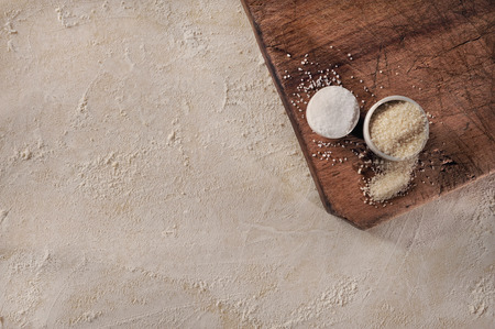 Customizable cooking recipe setup, homemade baking dough and sugar over vintage wooden support, top view  photo