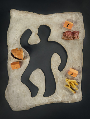 Unhealthy food victim  Crime scene, a silhouette of a man made out of baking dough  Next to the victim s silhouette there are several evidences about the cause of death, a piece of bacon, a hamburger, fries The image can be easily customized   photo