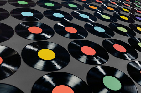 lps: Music - Vinyl records  Colorful collection of vinyl records, LPs, on dark grey background, angle view  The labels can be easily customized, the image is suitable for background use