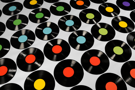 lps: Music - Vinyl records  Colorful collection of vinyl records, LPs, on grey background, angle view  The labels can be easily customized, the image is suitable for background use