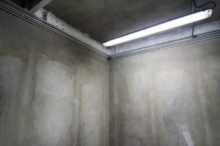 Raw concrete walls suitable for background use corner view. Archivio Fotografico