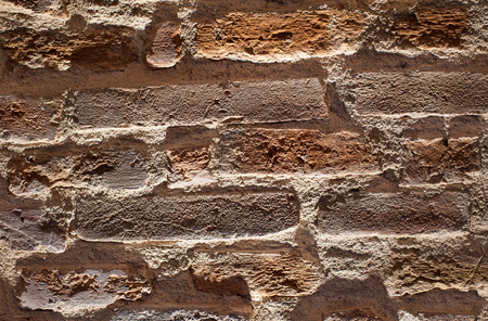 Brick wall background artistic and dramatic view using lights and shadows customizable background.