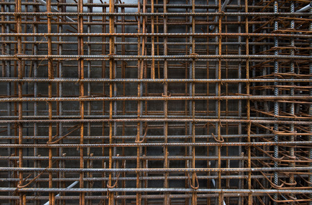 Steel bars reinforcement on construction site, vertical wall, editable background. Archivio Fotografico